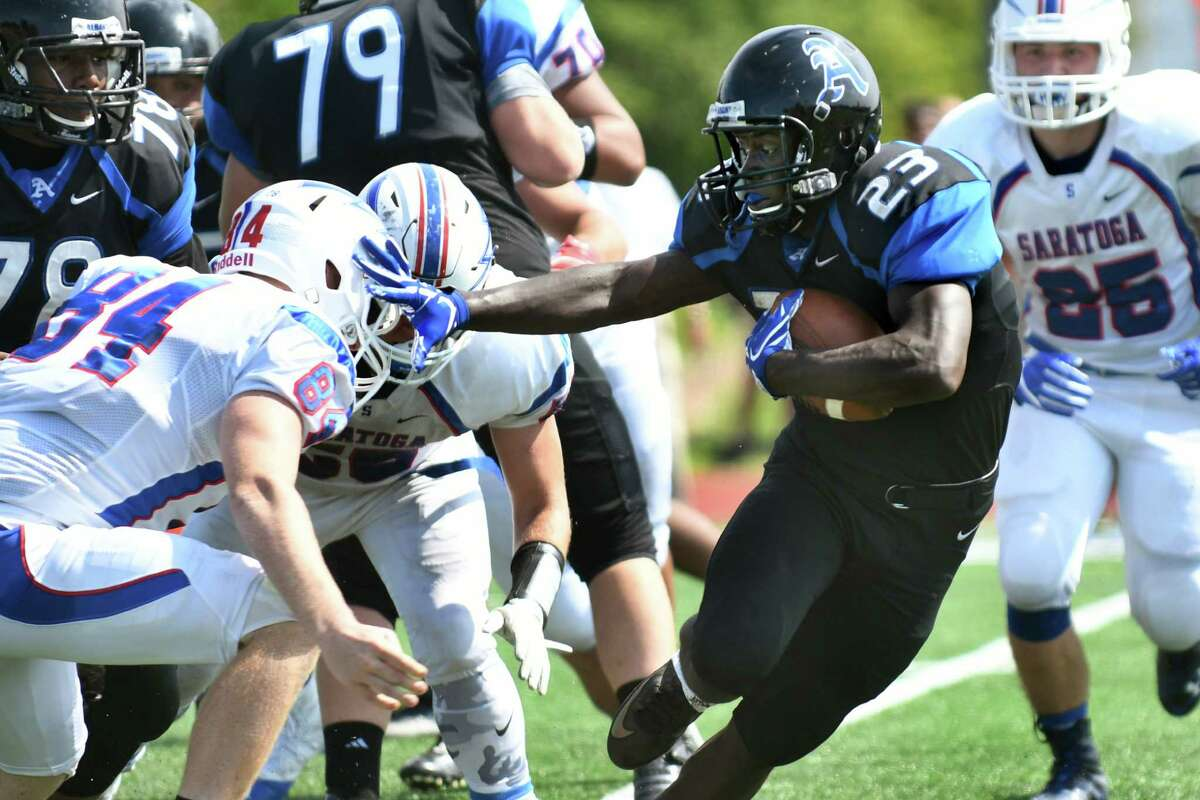 Albany's Ky'ere Tillery, second from right, stiff arms Saratoga's Dylan Honis during their football game on Saturday, Sept. 3, 2016, at Albany High in Albany, N.Y. (Cindy Schultz / Times Union)