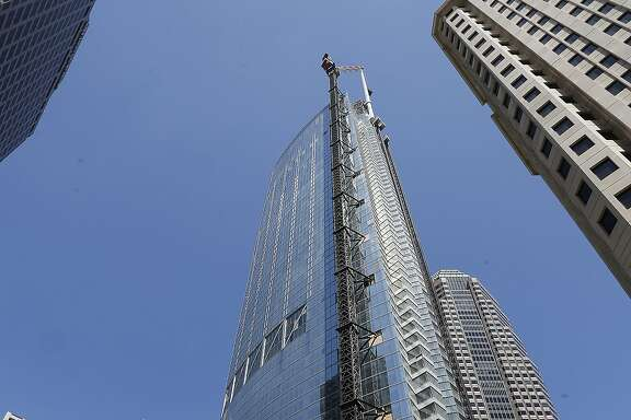 A 160-foot spire is seen atop the Wilshire Grand Tower building after a crane hoisted it into place early Saturday, Sept. 3, 2016. The 10-ton spire makes the building the tallest building west of the Mississippi River. It's now 1,099 feet high, 81 feet higher than the nearby U.S. Bank Tower, which held the tallest building record since 1989. The $1-billion hotel and office complex is scheduled to open next March. (AP Photo/Reed Saxon)