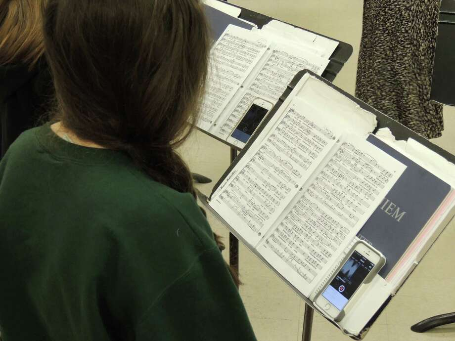 Students use a recording app to practice music.