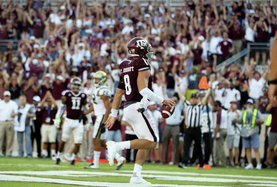 Texas A&M quarterback Trevor Knight (8) jogs into the end zone for the go ahead touchdown against UCLA in overtime of an NCAA college football game Saturday, Sept. 3, 2016, in College Station, Texas. Texas A&M won 31-24 in overtime. (AP Photo/Sam Craft) Photo: Sam Craft, Associated Press / AP