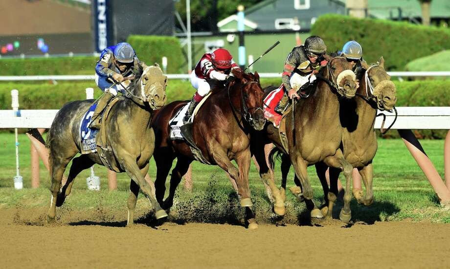 Shaman Ghost ridden by Javier Castellano, second from right puts a head in front to win the 63rd running of The Woodward at the Saratoga Race Course Saturday Sept. 3, 2016 in Saratoga Springs, N.Y.    (Skip Dickstein/Times Union) Photo: SKIP DICKSTEIN