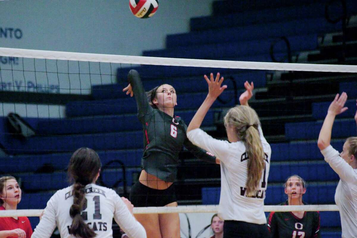 Oak Ridge's Molly Russell (6) goes up for a kill shot against Clear Creek during the BSN/Under Armour CCISD Volleyball Tournament Championship at Clear Springs High School Saturday, Sep. 3.