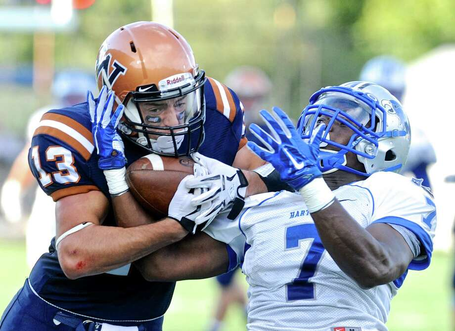 Western's Kyle Kessler (13) fights for the ball with Hartwick's Malik Wynter (7) to make the catch in the Hartwick College at Western Connecticut State University football game on Saturday afternoon, September 3, 2016, at the WCSU Westside Athletic Complex in Danbury, Conn. Photo: H John Voorhees III / Hearst Connecticut Media / The News-Times