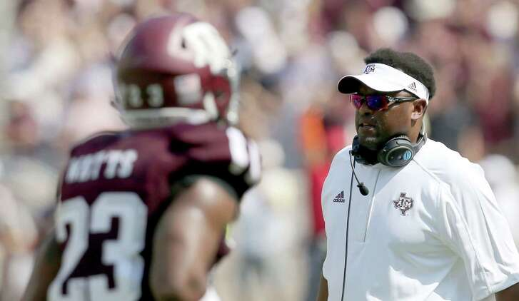 Texas A&M head coach Kevin Sumlin talks to his players as they come off the field during the second quarter against UCLA on Sept. 3, 2016, in College Station.