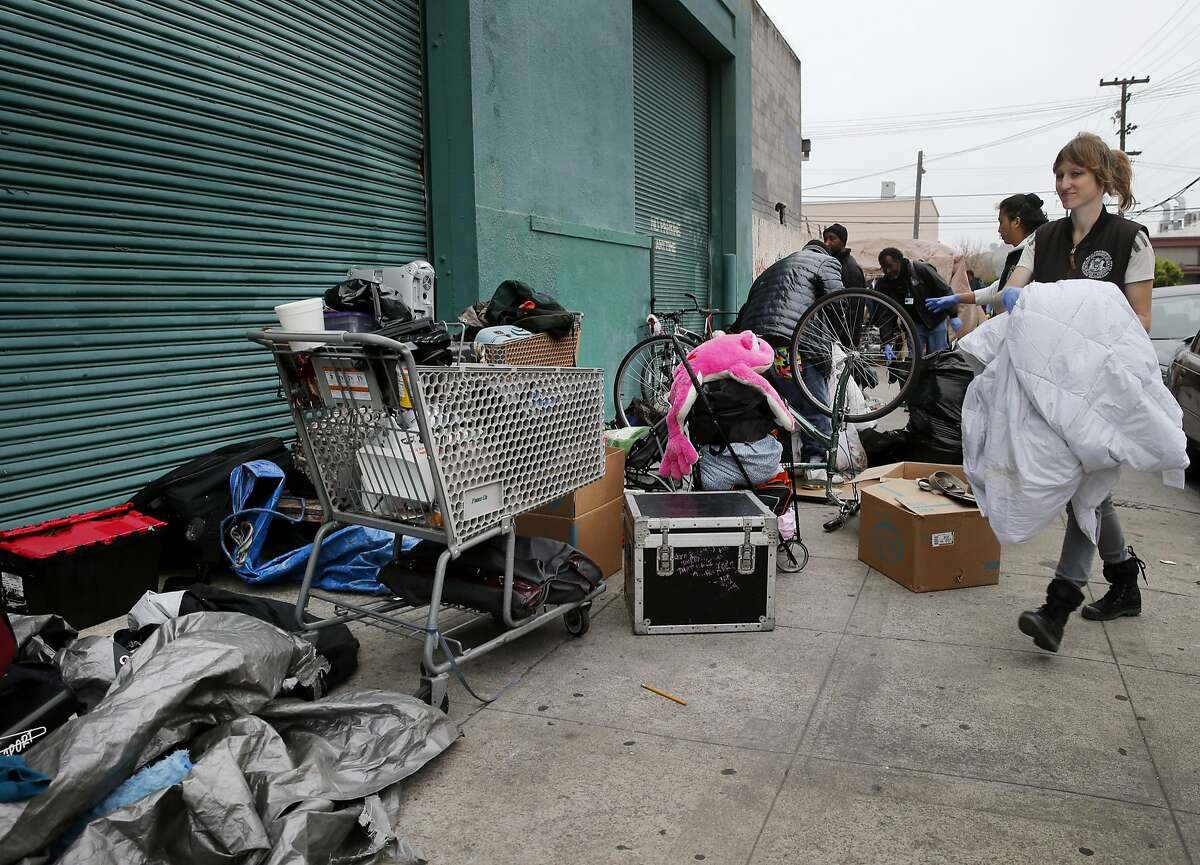 Hot team members helped clear out an encampment on Shotwell Street Monday April 20, 2015. A homeless encampment near the corner of 16th Street and Shotwell in San Francisco, Calif. was dismantled and the people moved to the new navigation center a few blocks away.