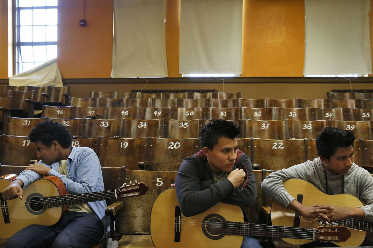 """From left, Mikas Teklegiorgis, 16, Thomy Alexis Pavon, 16, and Edvin Mejia, 16, pause between practicing songs during a mariachi class at Mission High School March 11, 2015 in San Francisco, Calif. The class will be performing in a free show called """"�Viva el Mariachi!"""" at 7:30pm on March 19 at the Mission High School Auditorium."""