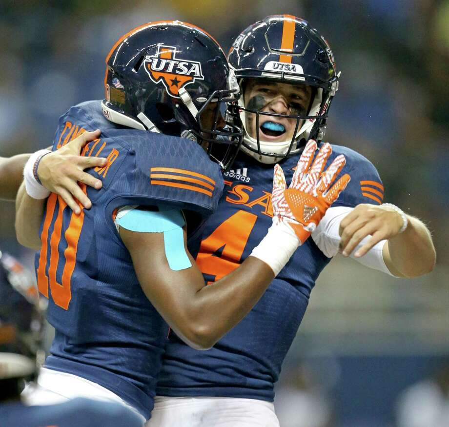 UTSA Roadrunners wide receiver Greg Campbell Jr. (left) celebrates with quarterback Dalton Sturm after Sturm scored a touchdown during first half action against the Alabama State Hornets on Sept. 3, 2016 at the Alamodome. Photo: Edward A. Ornelas /San Antonio Express-News / © 2016 San Antonio Express-News
