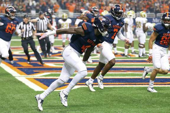 UTSA wide receiver Marquez McNair (center) celebrates after scoring a touchdown during first-half action against the Alabama State Hornets on Sept. 3, 2016 at the Alamodome.