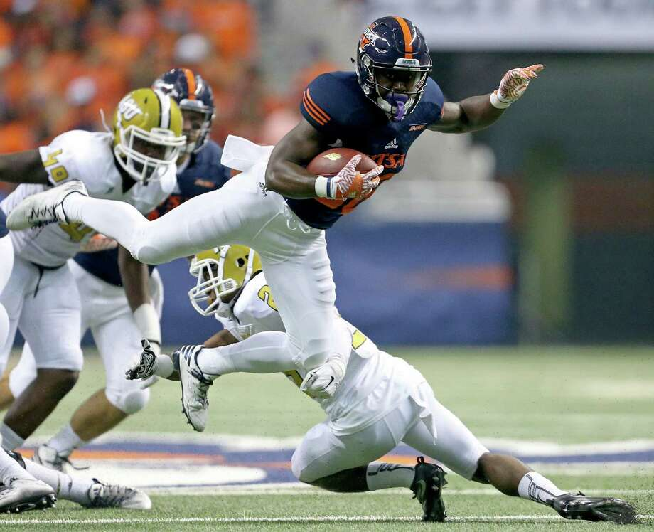 UTSA Roadrunners running back Jalen Rhodes looks for room over Alabama State Hornets defensive back Davian Brantley during first half action Saturday Sept. 3, 2016 at the Alamodome. Photo: Edward A. Ornelas, Staff / San Antonio Express-News / © 2016 San Antonio Express-News