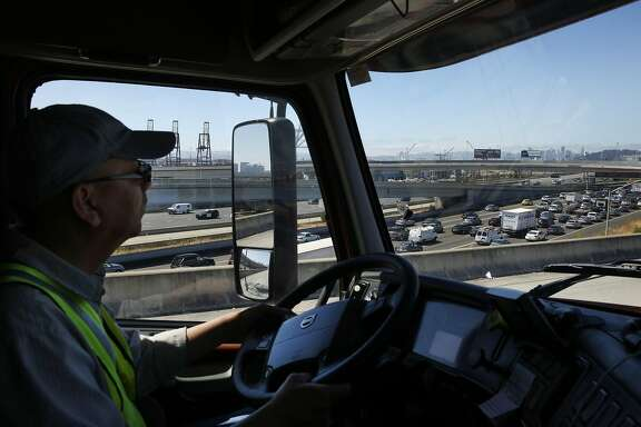 Ted Chen, 56, drives his truck towards the Bay Bridge Aug. 31, 2016 in Oakland, Calif. to pick up recycled materials from Recology for export from the Port of Oakland. Chen, who has been driving trucks for 18 years, feels that autonomous trucks might be dangerous.