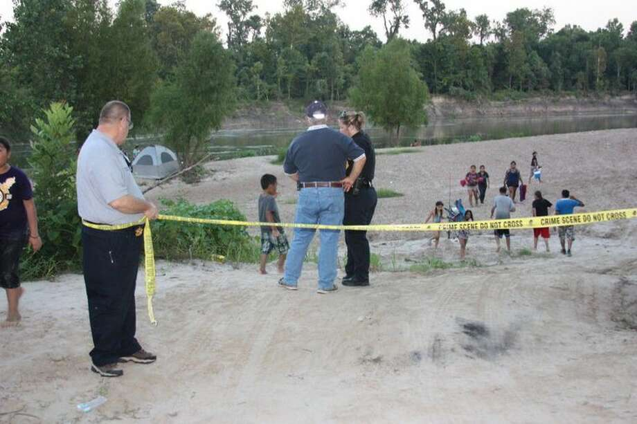 The Liberty County Sheriff's Office set up a makeshift perimeter about a quarter-mile from where a single-propeller plane went down Saturday night in the Trinity River near Moss Hill. Two people on the plane reportedly were killed. - Vanesa Brashier