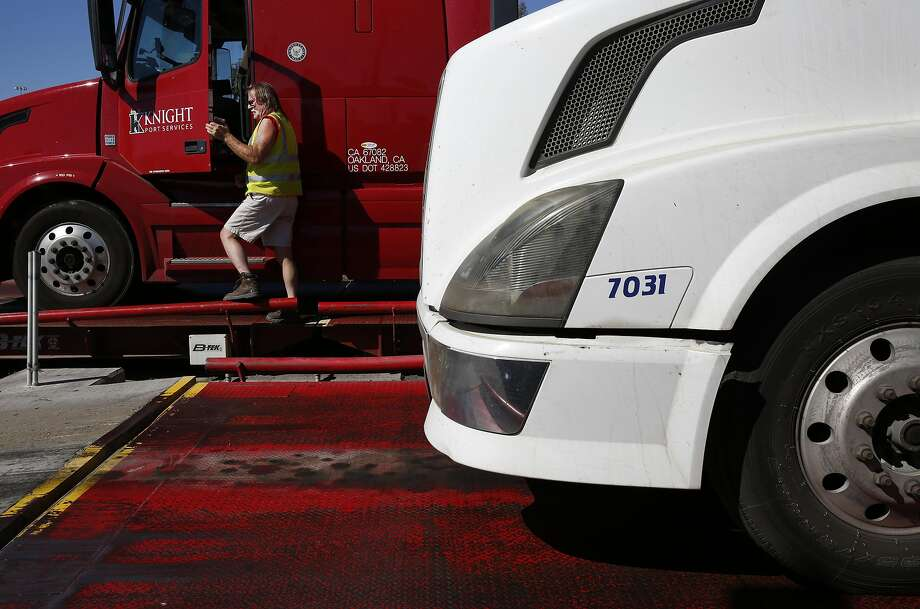 """Truck driver Mike McLendon, stopping to weigh his rig near the Port of Oakland, calls self-driving vehicles a """"losing proposition."""" Photo: Leah Millis, The Chronicle"""