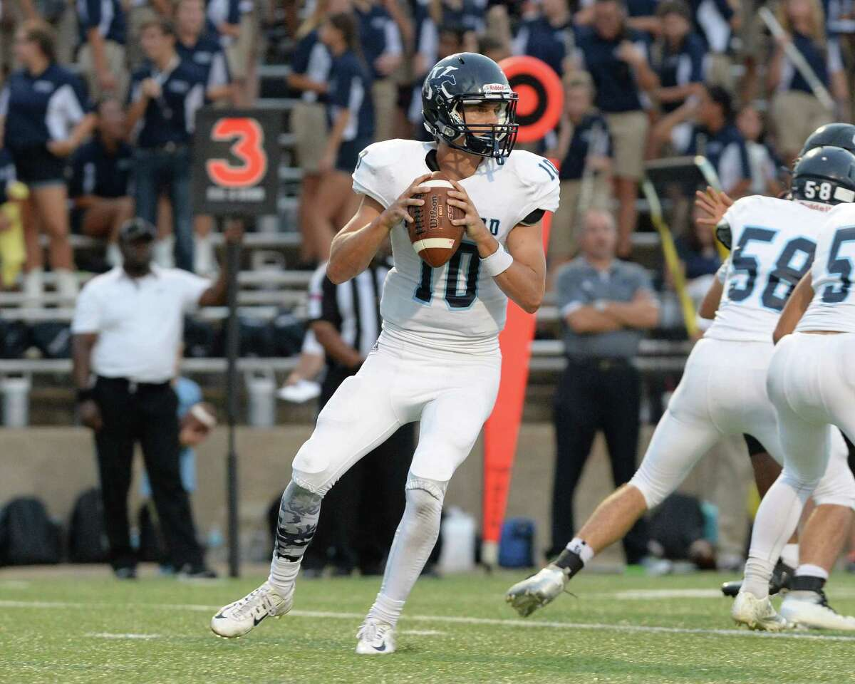 Quarterback Dawson Trudell (10) of Kingwood drops back for a pass to Eric Hammersmith (5), resulting in an 81 yard gain and touchdown in the third quarter of a high school football game between Ft. Bend Austin and Kingwood on September 3, 2016 at Mercer Stadium, Sugar Land, TX.
