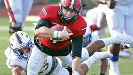 Incarnate Word quarterback Trent Brittain stretches for yards after busting out of the pocket away from Texas A&M-Kingsville defender at Benson Stadium on Sept. 3, 2016, in San Antonio.