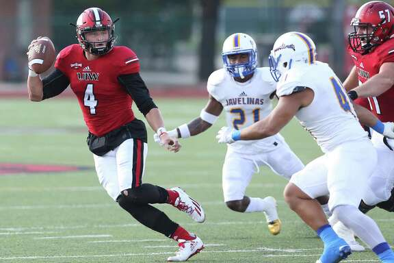 UIW quarterback Trent Brittain rolls to the outside against Texas A&M-Kingsville at Benson Stadium on Sept. 3, 2016.