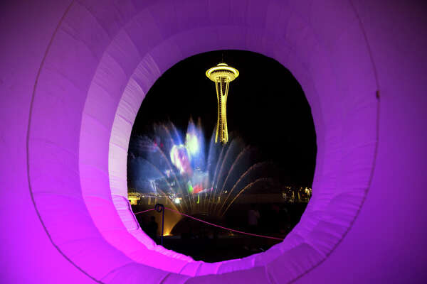 "The Space Needle and the International Fountain are seen through the O in an inflatable ""Bumbershoot"" on day two of Bumbershoot, Saturday, Sept. 3, 2016."
