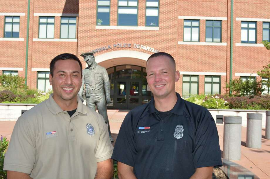 Officers Gabriel DeMott (right) and Joseph Frattaroli (left) recently stepped into their new roles as school resources officers, each dividing their time between a middle school and three elementary schools. Photo: Contributed Photo