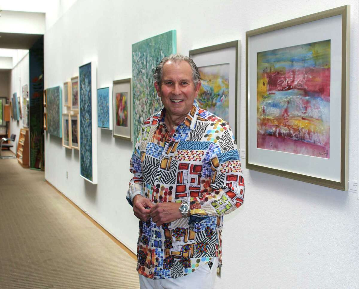 Mark Schiff, Norwalk artist, stands in front of his exhibit at the Wilton Library at 137 Old Ridgefield Road. The exhibit will be held from Sept. 9 to Oct. 7.
