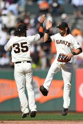 SAN FRANCISCO, CA - AUGUST 31:  Brandon Crawford #35 and Angel Pagan #16 of the San Francisco Giants celebrate defeating the Arizona Diamondbacks 4-2 at AT&T Park on August 31, 2016 in San Francisco, California.  (Photo by Thearon W. Henderson/Getty Images)