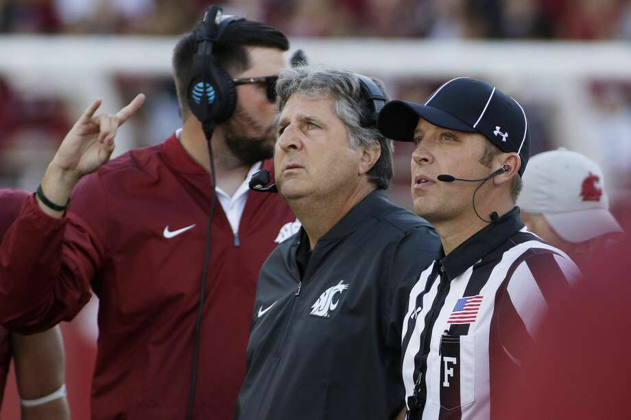 Washington State head coach Mike Leach, center, watches a replay during the first half of an NCAA college football game against the Eastern Washington in Pullman, Wash., Saturday, Sept. 3, 2016. (AP Photo/Young Kwak) Photo: Young Kwak/AP