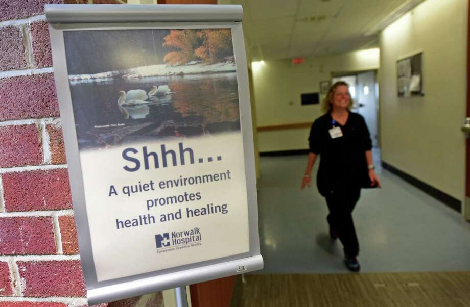 A sign asks staff and visitors to keep quiet for patient health at Norwalk Hospital. The hospital uses the signs and patient earplugs to make it easier for patients to sleep, and therefore heal. Photo: Erik Trautmann / Hearst Connecticut Media / Norwalk Hour