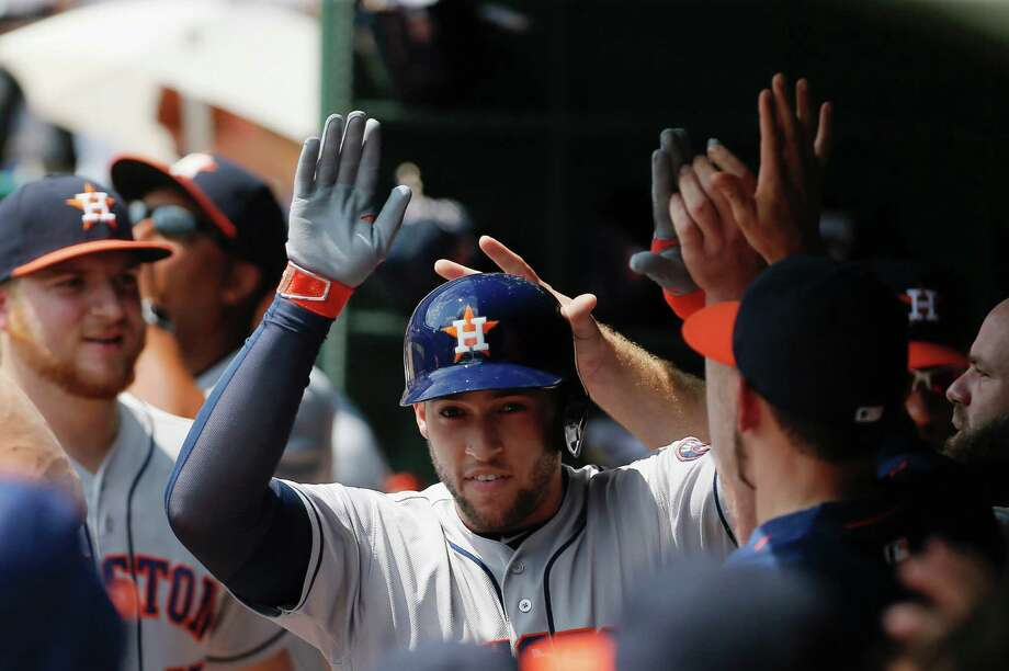 ARLINGTON, TX - SEPTEMBER 04: George Springer of the Houston Astros is congratulated by teammates after hitting a solo home run during the first inning of a baseball game against the Texas Rangers at Globe Life Park in Arlington on September 4, 2016 in Arlington, Texas. Photo: Brandon Wade, Getty Images / 2016 Getty Images