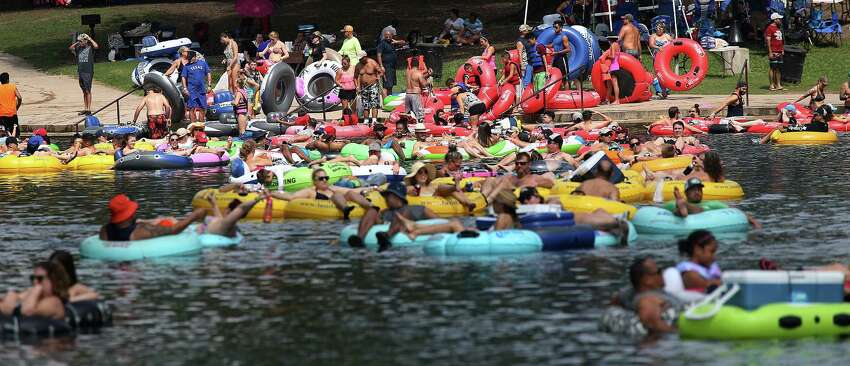 People enjoy tubing the Comal River by Prince Solms Park in New Braunfels, Texas, Sunday, Sept. 2, 2016. It is the last weekend of summer and people took to the water.