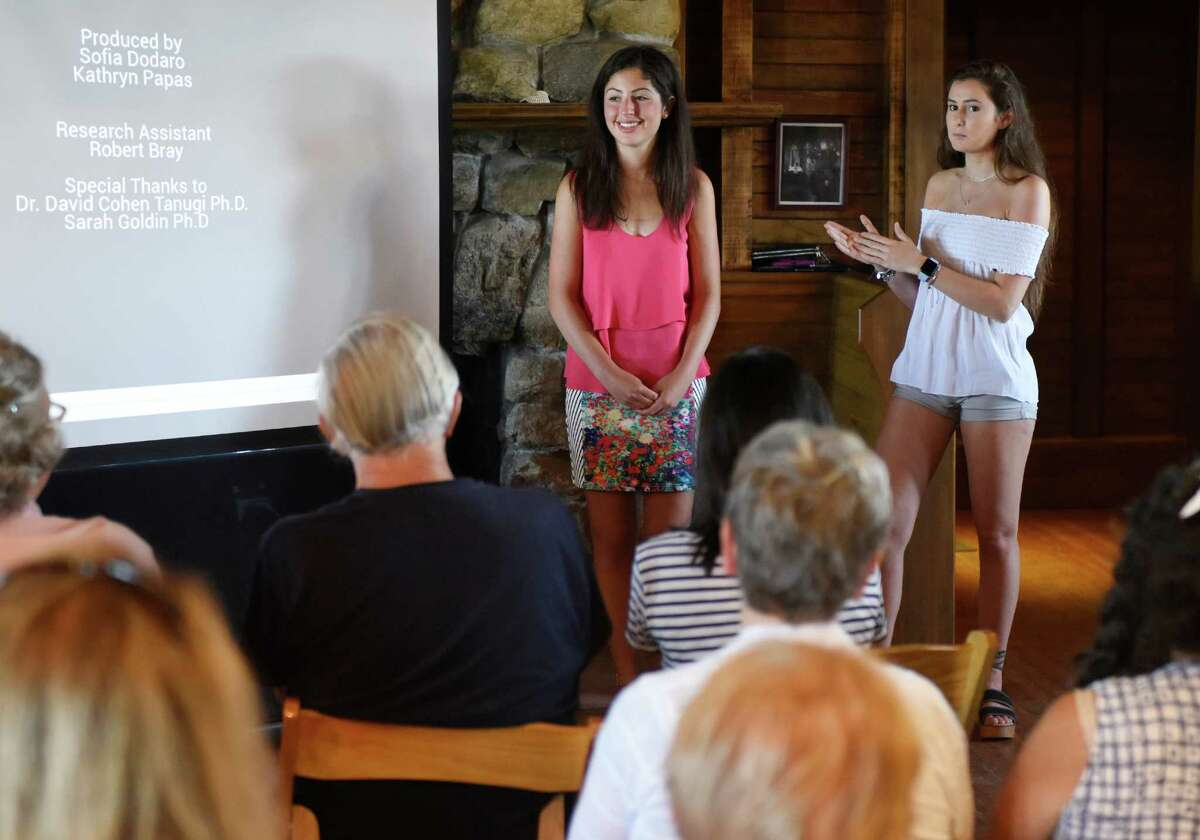 Greenwich High School juniors Kathryn Papas, left, and Sofia Dodaro, right, answer audience questions after screening their documentary film