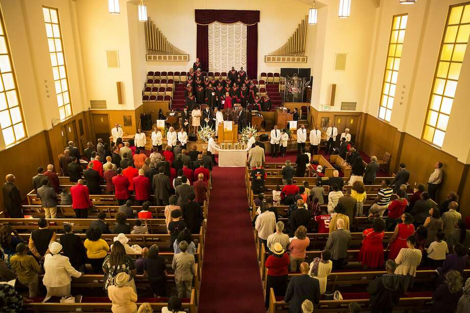 """Members of the congregation stand during communion at Third Baptist Church where San Francisco quarterback Colin Kaepernick was scheduled to speak in San Francisco, Calif. on Sunday, Sept. 4, 2016. Kaepernick was unable to attend due to """"rigors of training,"""" according to Rev. Amos Brown. Photo: Stephen Lam, Special To The Chronicle"""