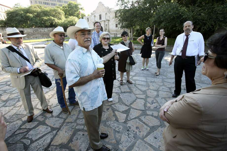 Andres Tijerina brings up the idea that the Alamo defenders were the first to lock themselves inside the mission for defense as the city's Alamo Plaza Commission tours the site on May 28, 2014. Photo: Tom Reel /San Antonio Express-News / San Antonio Express-News
