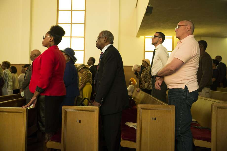 "Members of the congregation stand during Sunday service at Third Baptist Church where San Francisco quarterback Colin Kaepernick was scheduled to speak in San Francisco, Calif. on Sunday, Sept. 4, 2016. Kaepernick was unable to attend due to ""rigors of training,"" according to Rev. Amos Brown. Photo: Stephen Lam, Special To The Chronicle"