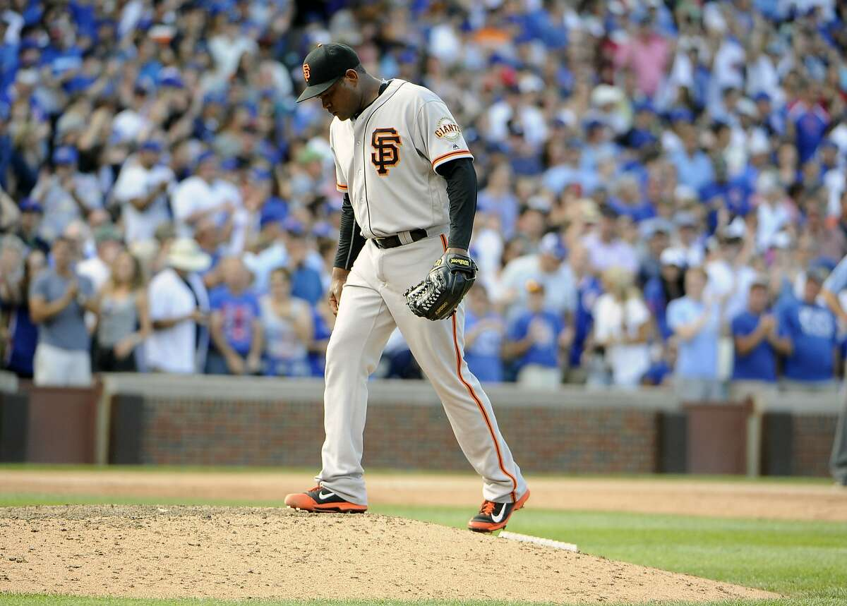 San Francisco Giants relief pitcher Santiago Casilla reacts after giving up the tying run to the Chicago Cubs during the ninth inning of a baseball game, Sunday, Sept. 4, 2016, in Chicago. (AP Photo/David Banks)