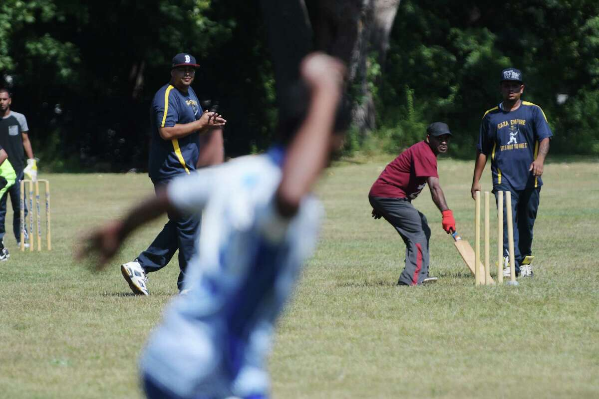 Players take part in a cricket competition as part of the annual Guyana Day celebration at Grout Park on Sunday, Sept. 4, 2016, in Schenectady, N.Y. In May, the country of Guyana celebrated 50 years of independence. (Paul Buckowski / Times Union)