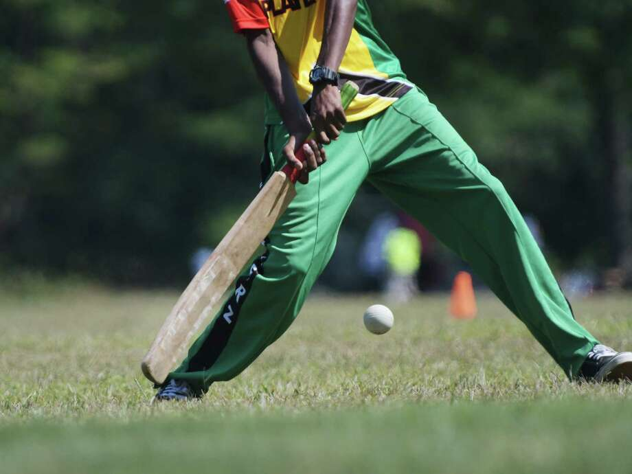 A player takes a swing during a cricket competition as part of the annual Guyana Day celebration at Grout Park on Sunday, Sept. 4, 2016, in Schenectady, N.Y. (Paul Buckowski / Times Union) Photo: PAUL BUCKOWSKI / 20037890A