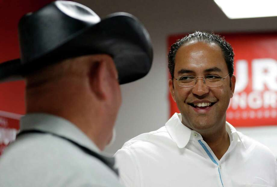 In this Saturday, Aug. 27, 2016 photo, first-term Republican Rep. Will Hurd, right, of Texas, talks with a supporter at a campaign office, in San Antonio. Many House Republican incumbents worry that blowback from Republican presidential nominee Donald Trump's anti-Hispanic rhetoric and promises to build a towering wall the length of the U.S.-Mexico border could hurt their re-election chances, a problem especially acute for those in heavily Latino districts like that of Hurd, whose territory encompasses 820 miles of the U.S.-Mexico border. (AP Photo/Eric Gay) Photo: Eric Gay, STF / Copyright 2016 The Associated Press. All rights reserved.