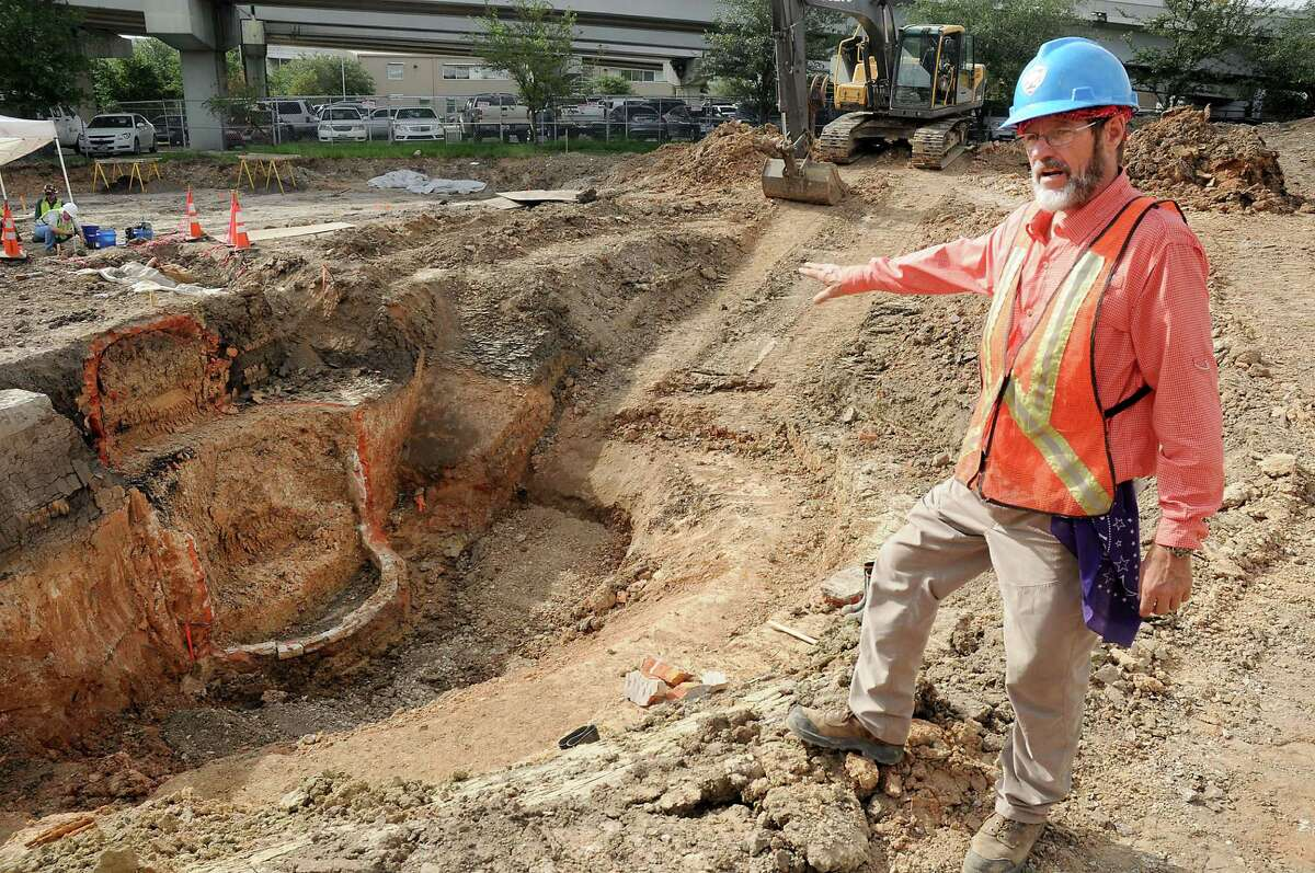 DOT archaeologists Doug Boyd shows the area where a cistern lies at the site of Frost Town at 512 McKee downtown Friday July 15,2016.(Dave Rossman Photo)