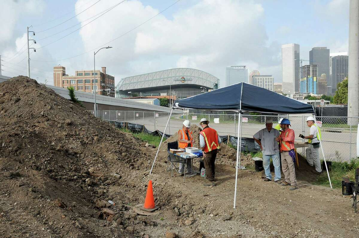 Volunteers fro the Houston Archeological Society work during a dig at the site of Frost Town at 512 McKee downtown Friday July 15,2016.(Dave Rossman Photo)