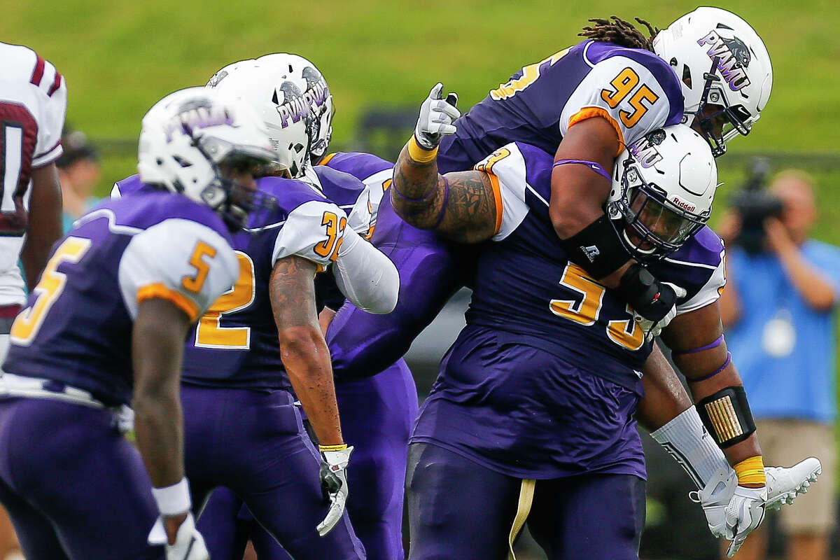 Prairie View Am Panthers defensive tackle DeVohn Reed (95) jumps on the back of linebacker Don Rittenhouse (55) to celebrate after Rittenhouse made a tackle as the Prairie View Am Panthers take on the Texas Southern Tigers at Panther Stadium at Blackshear Field Sunday, September 4, 2016 in Prairie View.