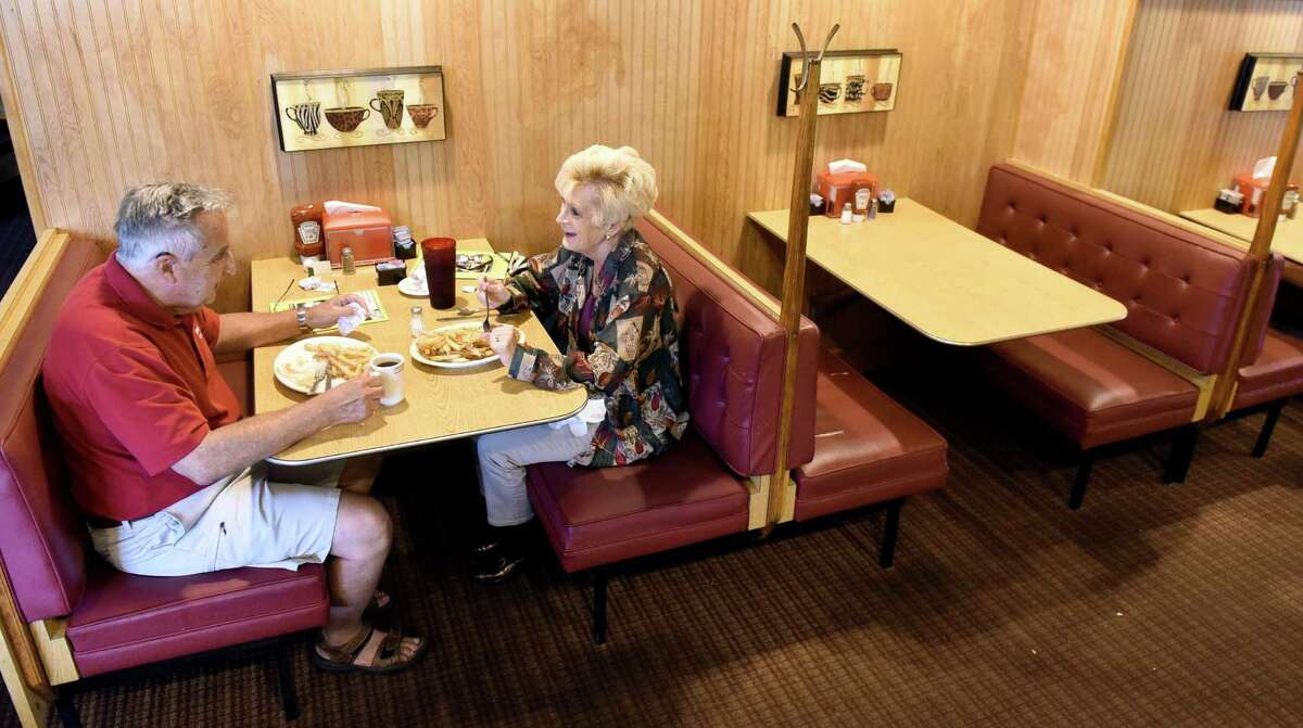 Dick and Katey Holmes of Loudonville have an early dinner on Thursday, Sept. 1, 2016, at Howard Johnson's restaurant in Lake George Village, N.Y. Katey Holmes, a Long Lake native, said she's been dining at this restaurant since she was a child. After Labor Day weekend, this Howard Johnson's will be the last of its kind in the country. (Cindy Schultz / Times Union)