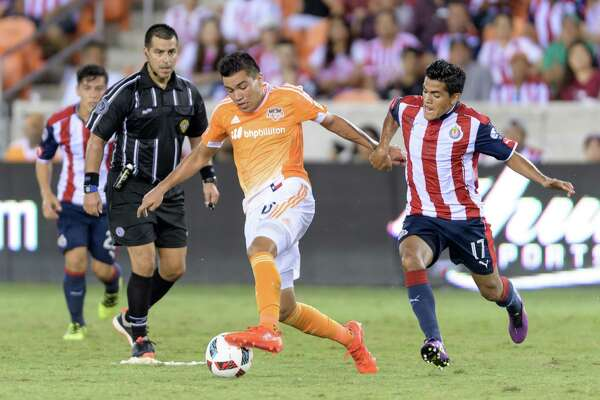 JosŽ Escalante (23) of the Houston Dynamo keeps Jesus Sanchez (17) of C. D. Guadalajara away from the ball in the second half in a friendly soccer match on Sunday, September 4, 2016 at BBVA Compass Stadium in Houston Texas.