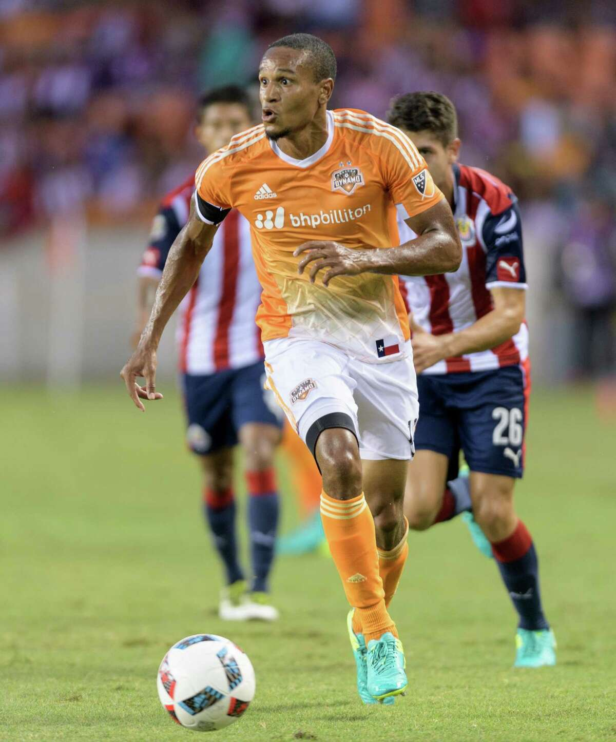 Ricardo Clark (13) of the Houston Dynamo brings the ball up the field in the first half against C. D. Guadalajara in a friendly soccer match on Sunday, September 4, 2016 at BBVA Compass Stadium in Houston Texas.