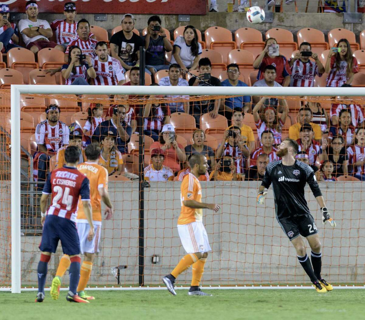 Houston Dynamo Goalkeeper, Calle Brown (24) watches a C. D. Guadalajara kick go over the goal in a friendly soccer match on Sunday, September 4, 2016 at BBVA Compass Stadium in Houston Texas.