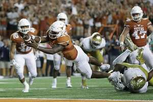 AUSTIN, TX - SEPTEMBER 04:  Tyrone Swoopes #18 of the Texas Longhorns dives in for the game winning touchdown in the second overtime against the Notre Dame Fighting Irish at Darrell K Royal-Texas Memorial Stadium on September 4, 2016 in Austin, Texas.