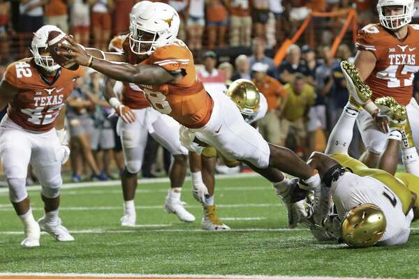 Longhorn quarterback Tyrone Swoopes stretches the ball in for the game winner touchdown in the second OT as Texas hosts Notre Dame at DKR Stadium on September 4, 2016.
