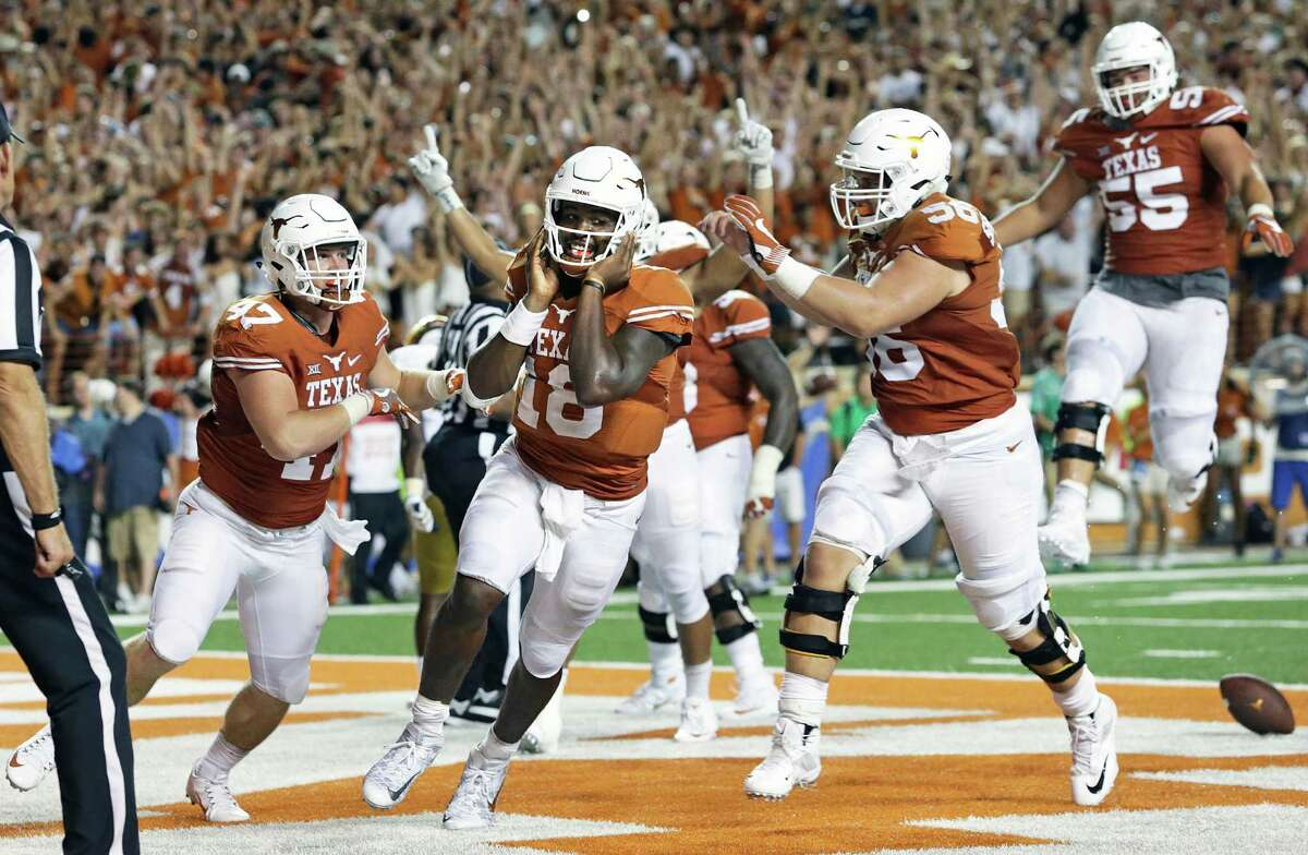 """Sept. 4: Texas 50, Notre Dame 47 (2OT) The Longhorns turned to the """"18-wheeler"""" package in overtime. Tyrone Swoopes scored two rushing touchdowns in extra time to give Charlie Strong his signature win in three seasons at Texas. Record: 1-0"""