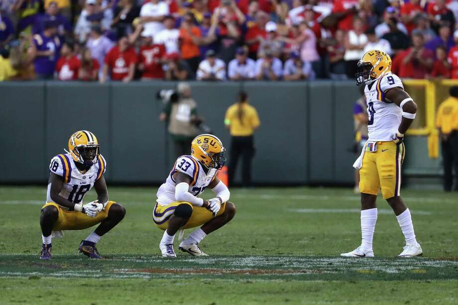 Tre'Davious White #18, Jamal Adams #33 and Rickey Jefferson #9 of the LSU Tigers react after being defeated 16-14 by the Wisconsin Badgers at Lambeau Field on September 3, 2016 in Green Bay, Wisconsin. Photo: Jonathan Daniel, Staff / 2016 Getty Images