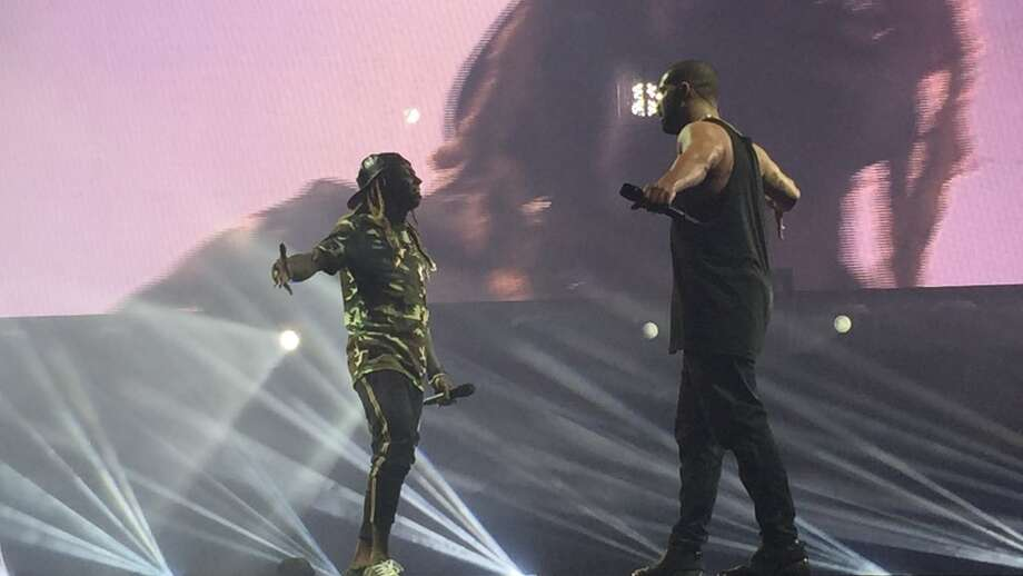 Drake surprised Houston with Lil Wayne during Sunday's second show at Toyota Center. Photo: Toyota Center (Twitter & Instagram: @ToyotaCenter)
