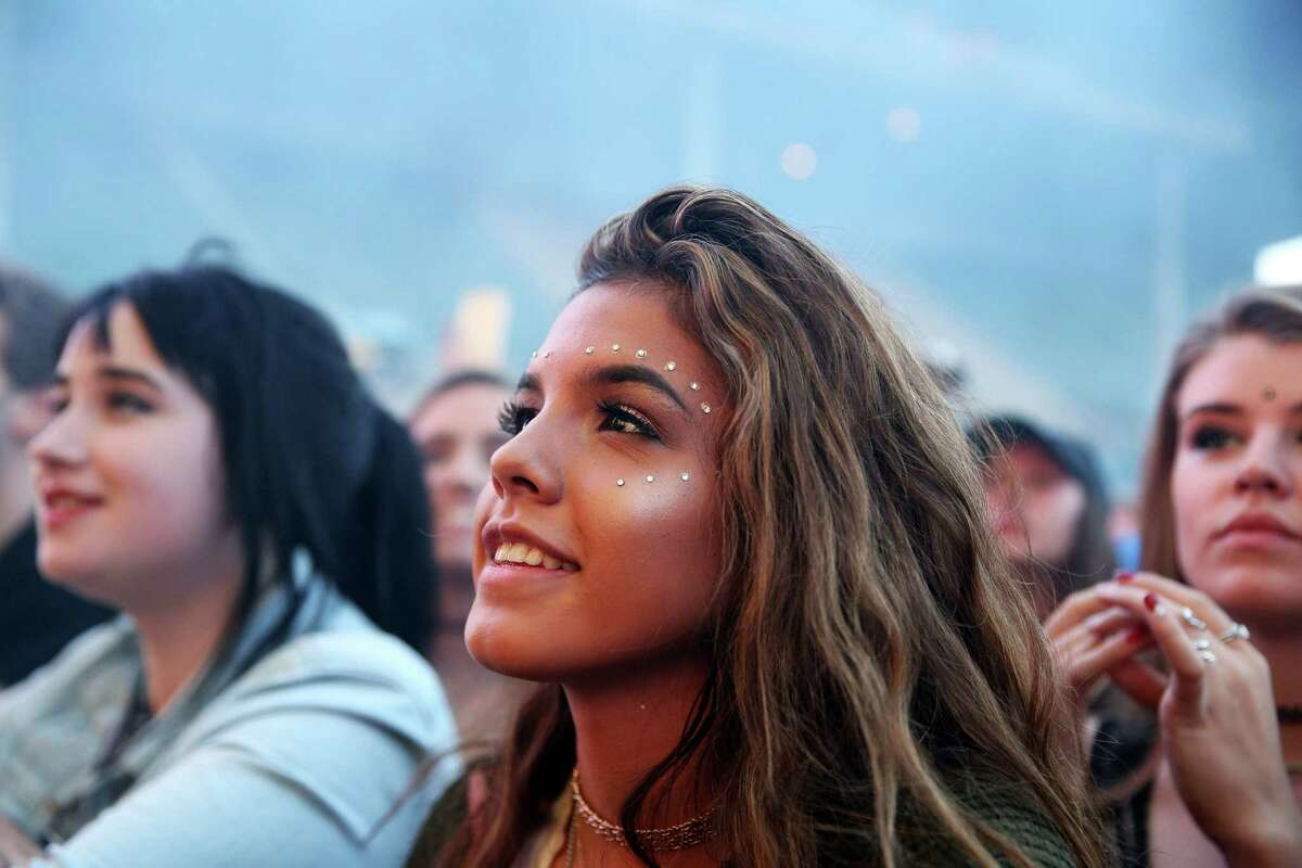 Fans listen as Tame Impala performs on the Main Stage at Memorial Stadium, on day three of Bumbershoot,Sunday, Aug. 4, 2016.