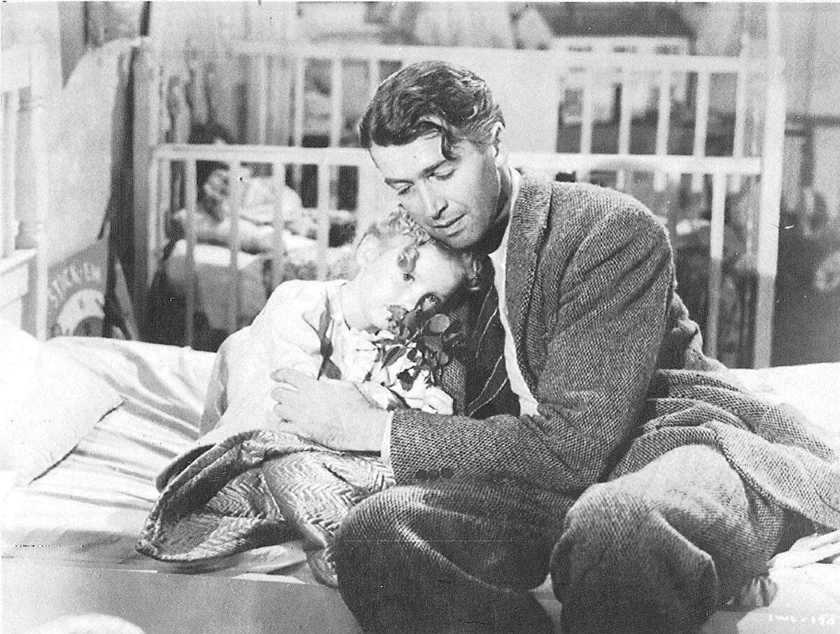 Karolyn Grimes (as Zuzu) and Jimmy Stewart (as George Bailey) in a scene from the 1946 film