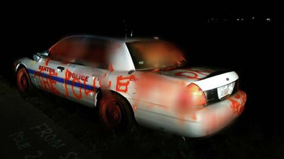 The Denton Police Department needs help from the public in finding the culprit behind the spray-painting of a squad car on Sept. 3, 2016. Photo: Denton Police Department